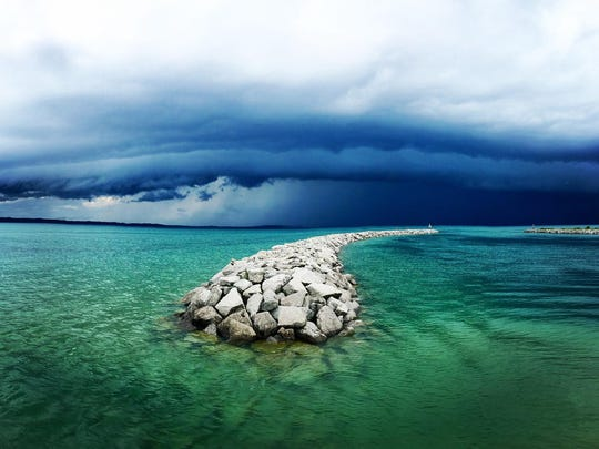"""""""Rolling Away on Traverse Bay,"""" by Rick Motyl of Troy, is a finalist in the digitally enhanced category."""