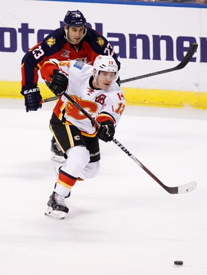 The New Jersey Devils signed left wing Mike Cammalleri (13), shown last season with the Calgary Flames, to a five-year, $25 million contract on Tuesday, the first day of the NHL's free-agency period.