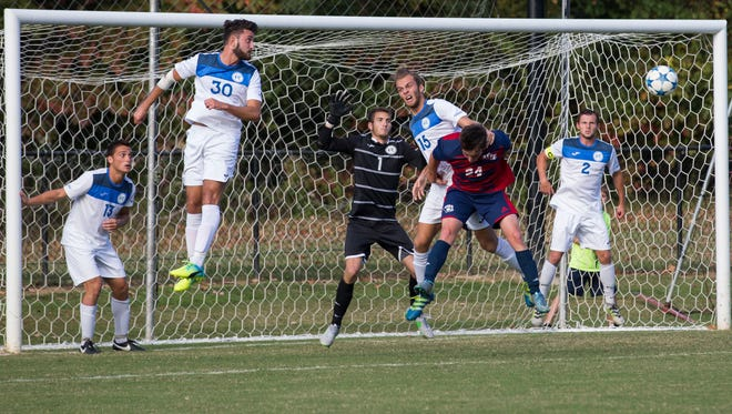 Rockhurst players try to defend their goal as USI's Riley Belding tries to knock the ball in after a corner kick during the game on Sunday afternoon.