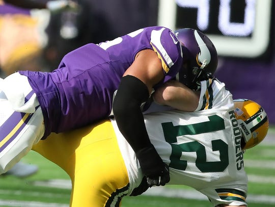 Green Bay Packers quarterback Aaron Rodgers gets flattened