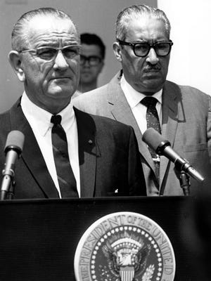 Solicitor General Thurgood Marshall stands behind U.S. President Lyndon Johnson at the White House on June 13, 1967, as the chief executive announces he is nominating Marshall to serve on the Supreme Court.