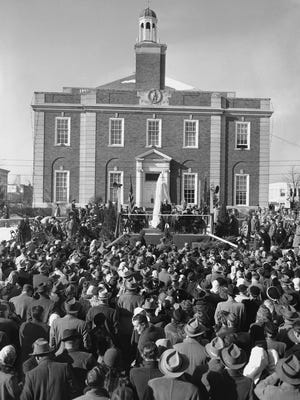 President Harry S. Truman addresses a crowd estimated at 1,500 on Dec. 26, 1949, in Independence, while presenting a 12-foot statue of Andrew Jackson to the people of Jackson County. The covered statue is behind the chief executive. Jackson County voters will decide in November if the statue will be removed.