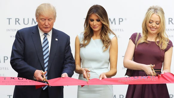 Donald Trump, Melania Trump and Tiffany Trump cut the