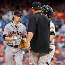 Aug 23, 2014; Washington, DC, USA; San Francisco Giants manager Bruce Bochy (R) removes Giants starting pitcher Tim Lincecum (55) from the game against the Washington Nationals in the third inning at Nationals Park. The Nationals won 6-2.