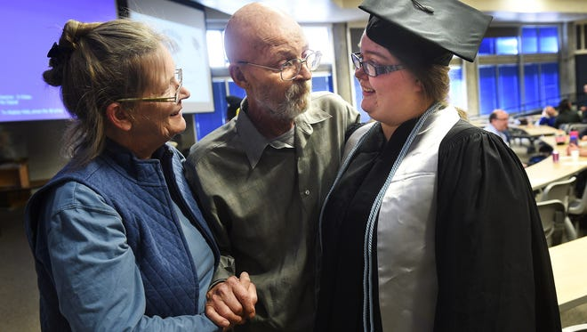 """Kendra Warthan, right, gets congratulated by her parents Diane Weinberg and Kenny Warthan at her """"Almost Commencement Ceremony"""" in the Jot Travis building at the University of Nevada, Reno on Jan. 31, 2017."""