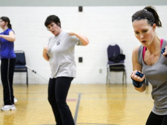 Crystal Kramer of Dover participates in a Les Mills BODYCOMBAT class at the Bob Hoffman YMCA in Dover Township. Daily Record/Sunday News -- Kate Penn