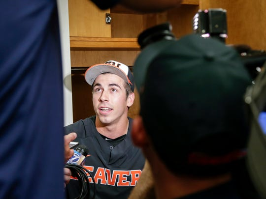 Oregon State pitcher Luke Heimlich answers reporters' questions in the clubhouse following practice at TD Ameritrade Park in Omaha, Neb., Friday, June 15, 2018. Oregon State plays North Carolina on Saturday in the NCAA College World Series baseball tournament.. (AP Photo/Nati Harnik)