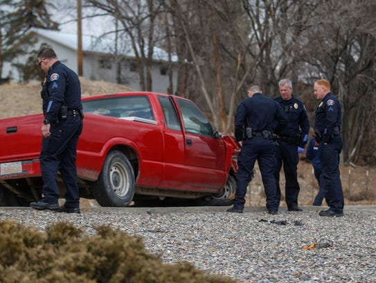 Farmington police officers inspect the vehicle involved in a police pursuit Feb. 16 at 400 Vine Ave. in Farmington.