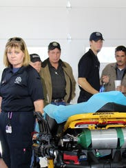 Lincoln County EMS staff shows off new ambulance bays.