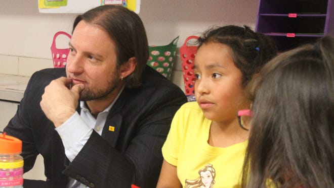 New Mexico Public Education Department Secretary-DesigneeChristopher Ruszkowski sits down with Loving Elementary School students in Haley Finch's class Tuesday, April 17, 2018.