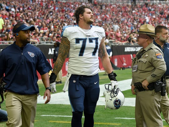 Titans offensive tackle Taylor Lewan (77) heads to