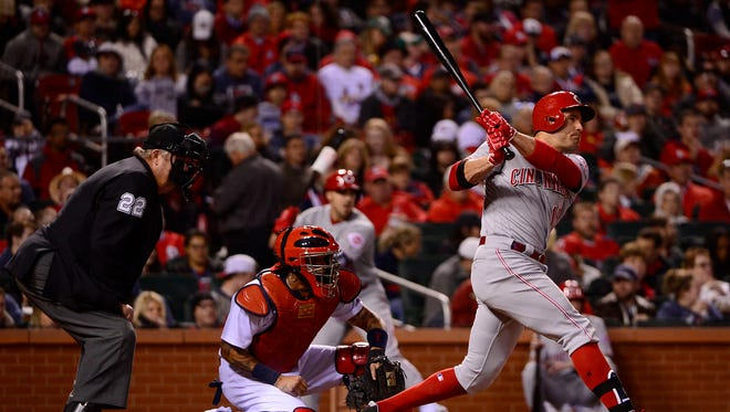 Cincinnati Reds first baseman Joey Votto (19) hits a one run double off of St. Louis Cardinals starting pitcher Mike Leake (not pictured) during the sixth inning at Busch Stadium.