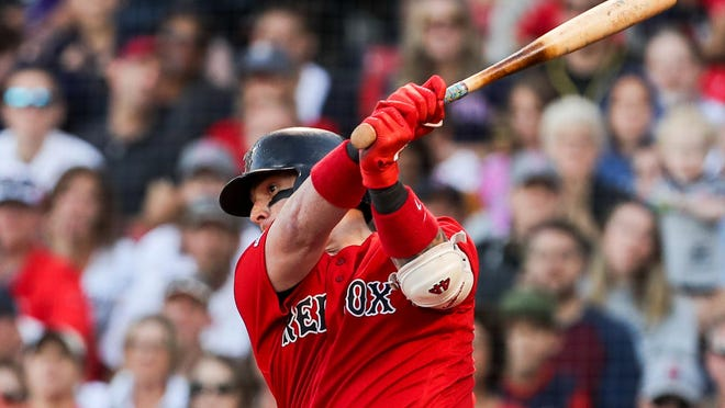 Boston Red Sox catcher Christian Vazquez  hits an RBI single against the Baltimore Orioles during a game last season at Fenway Park. Games without fans will begin in late July.