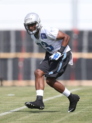 Cornerback Alex Carter goes through drills during Lions rookie minicamp May 9, 2015, at the Lions' training facility in Allen Park.