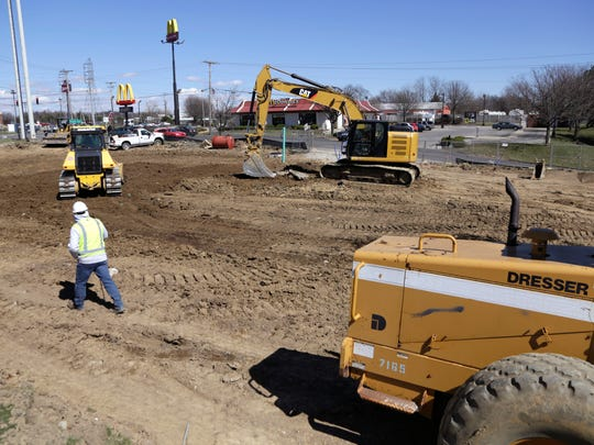 Construction crews work on the future location of the Tim Horton's restaurant at Ashland and Stewart roads on Friday. The first Tim Horton's in Richland County is expected to open this summer.