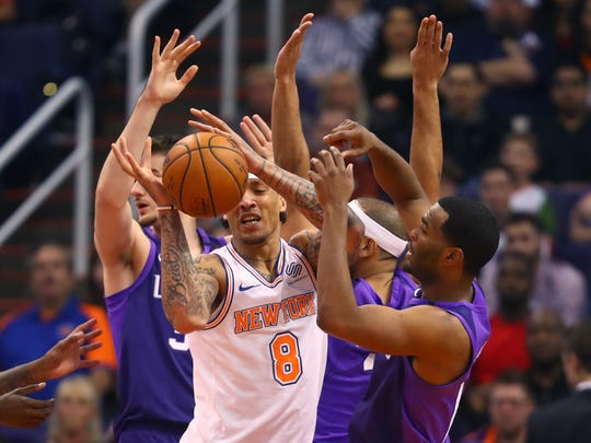 Jan 26, 2018; Phoenix, AZ, USA; New York Knicks forward Michael Beasley (8) controls the ball against the Phoenix Suns in the first half at Talking Stick Resort Arena.