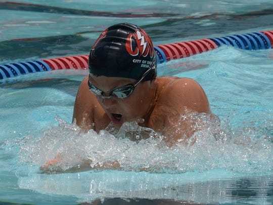 Garrett Chaisson of COSST takes a breath during his heat in the Boys 200M Breaststroke.