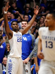 Kentucky forward Alex Poythress (22) celebrates as