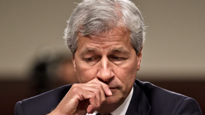 In this Wednesday, June 13, 2012,  file photo, JPMorgan Chase CEO Jamie Dimon  testifies on Capitol Hill in Washington.