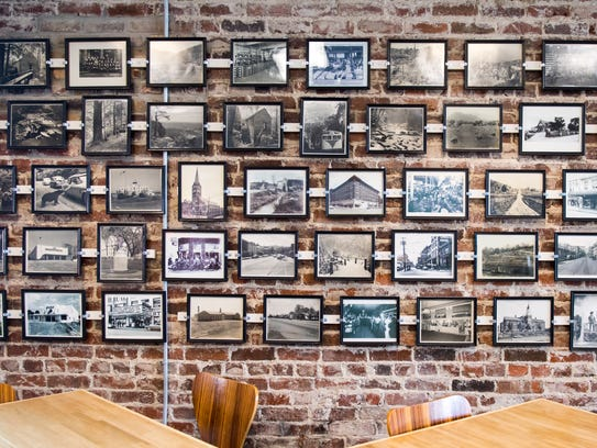 Old photos line the wall at Steamboat Sandwiches in