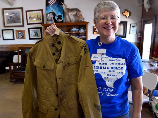Becky Wallace holds the U.S. Army uniform of her grandfather