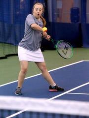 Meghan Maynard plays tennis as part of the Buddy Up