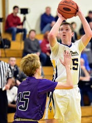 Ian Gelsinger of Greencastle shoots over Northern York's