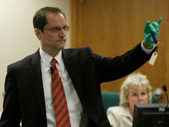Steven Avery's defense attorney Jerome Buting holds up Teresa Halbach's keys during his closing argument in the courtroom on March 14, 2007 at the Calumet County Courthouse in Chilton.