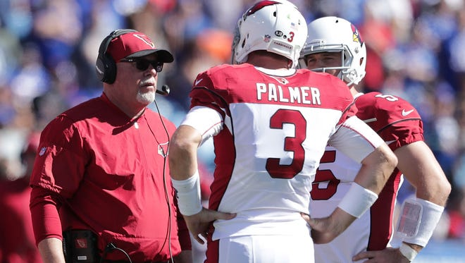 Bruce Arians talks with  Carson Palmer during a timeout in the first half against the Buffalo Bills on Sept. 25, 2016 in Orchard Park, New York.