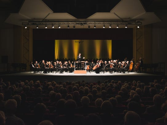 The Asheville Symphony, under the direction of Music