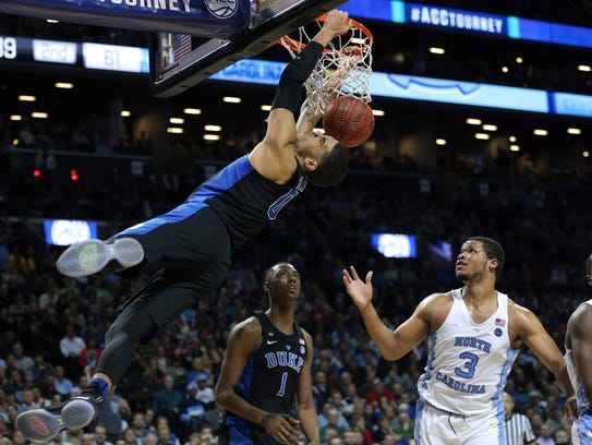 Duke forward Jayson Tatum throws down a dunk in the