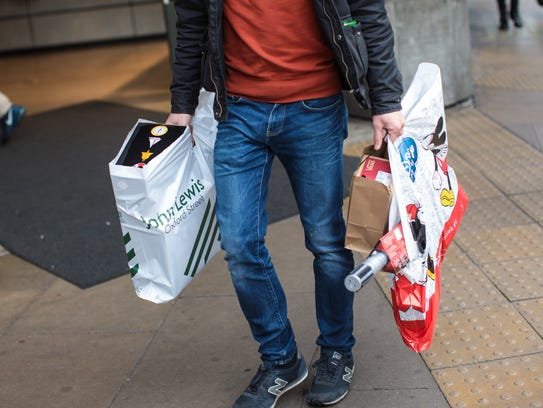 Carrying bags makes Christmas shoppers prey for thieves