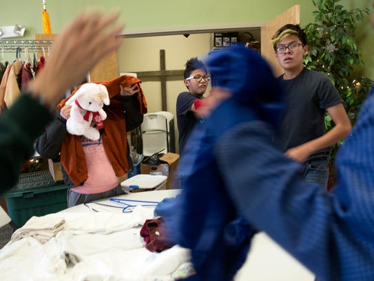 Children look over nativity costumes at Navajo Ministries in Farmington.