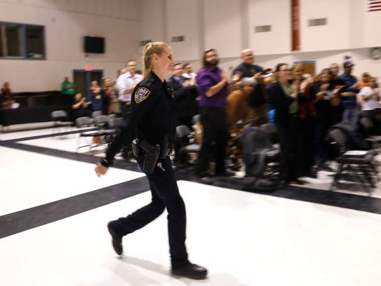 Sgt. Heather Knibbs, a school resource officer with the Aztec Police Department, is recognized during an Aztec Municipal School District board meeting on Tuesday at Aztec High School.
