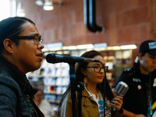 Kody Dayish, left, Alexandria Holiday and Kolin Dayish of the group Our Last Chants perform during the Winter Solstice Celebration on Thursday at the Farmington Public Library.