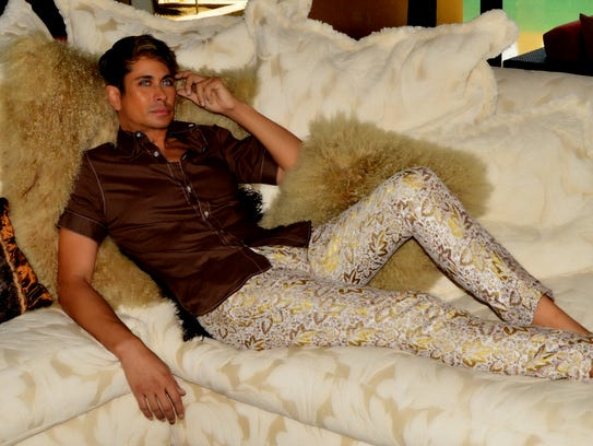 Reich wears a shirt and pant by Mario Guillen of G.Fraga.