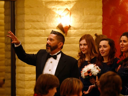 """Actor Steven Michael Quezada enters the set for the movie """"Aurora's Law"""" on Wednesday at the San Juan Country Club in Farmington."""