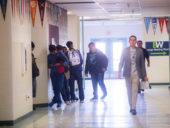 Students wait to enter class on Wednesday at the Bond Wilson Technical Center in Kirtland.