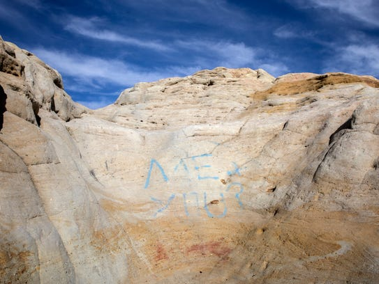 A spray-painted message is pictured on near a section of the rock crawl area on Wednesday, Jan. 31, at the Brown Springs Campground north of Farmington.