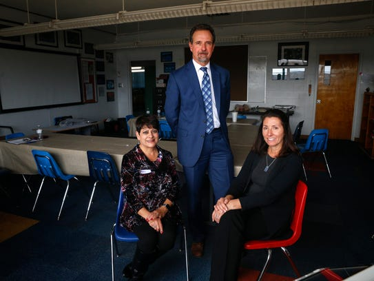 From left , Sacred Heart Catholic School Principal Rosalia Beyhan, Catholic School Management Lead Consultant Greg Dhuyvetter and Executive Consultant Maria J. Ribera pose for a photo on Friday at Sacred Heart Catholic School in Farmington.