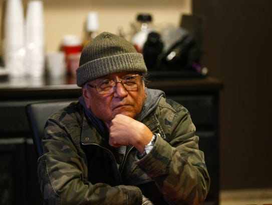 Artist Eugene Joe talks during an interview on Feb. 20 at the Capacity Builders offices in Farmington.