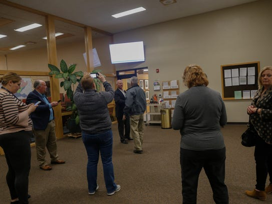 City of Farmington workers monitor election returns on Tuesday at Farmington City Hall.