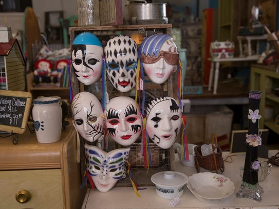 Masks are displayed Thursday at Downtown Junkers in downtown Farmington.