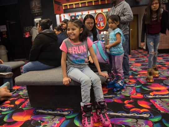 Aliah Wayne gets ready to skate with her friends Friday at the Rock N Roller Rink in Farmington.