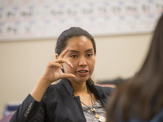 Navajo Prep senior Charvel Nez says her group's donation of books and money to a school in the Philippines damaged by typhoons will help students there continue their education.