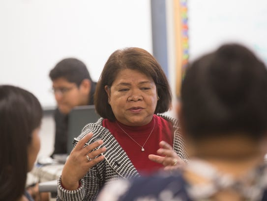 Navajo Prep science teacher Yolanda Flores escorted a group of her students to the Philippines recently as they delivered books and money to a school ravaged by typhoons.