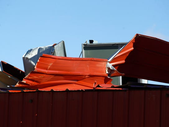 Wind damage to the roof of the Upper Fruitland Chapter house is visibleon Friday in Upper Fruitland.