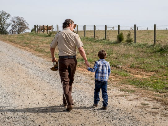 Rick Grimes (Andrew Lincoln) walks during happier times
