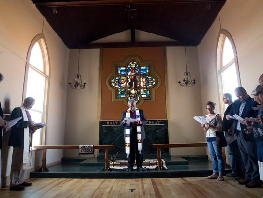 The Most Rev. Michael Curry, center, leader of the Episcopal Church, leads a service Wednesday at the Episcopal Church in Navajoland in Farmington.