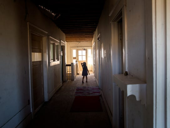 Elizabeth Dawes explores the hallways Wednesday at the Episcopal Church in Navajoland in Farmington.